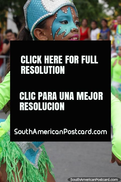 Young girl with fantastic makeup from the group Colegio Gimnasio Las Americas performs at the Festival of the Sea, Santa Marta. (480x720px). Colombia, South America.