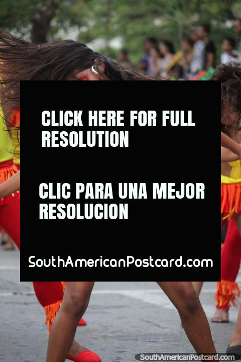 Girl in red, yellow and orange, dancing like a woman possessed, Festival of the Sea, Santa Marta. (480x720px). Colombia, South America.