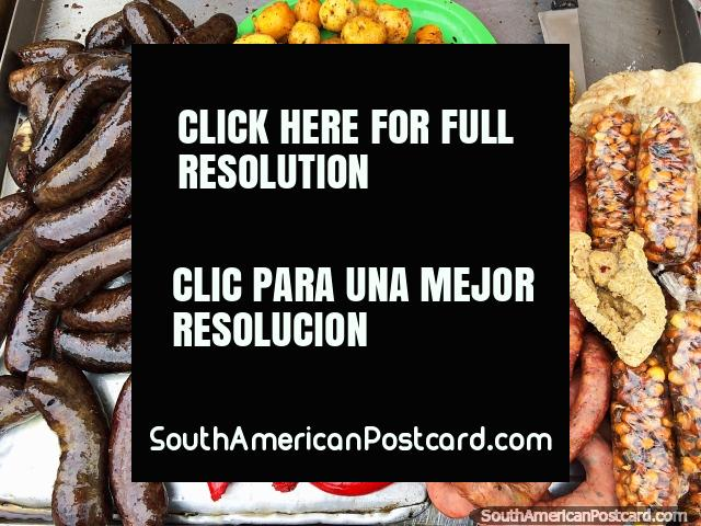 Blood sausage, red sausage and more plus potatoes, crackling and corn, street breakfast in Tunja. (640x480px). Colombia, South America.