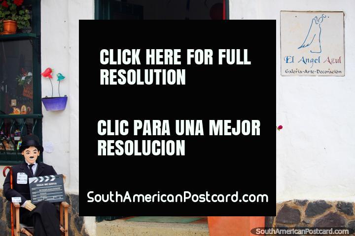 El Angel Azul, art gallery and decor, Charlie Chaplin sits outside, Villa de Leyva. (720x480px). Colombia, South America.