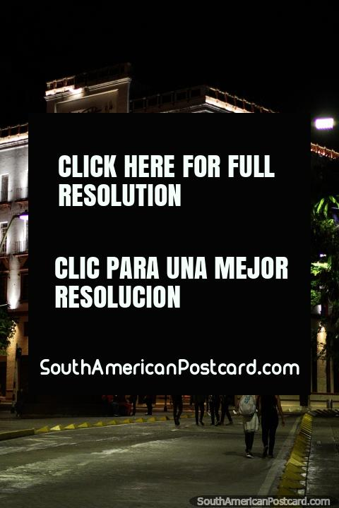 The Coltabaco Building at night with lights beside Poets Plaza in Cali. (480x720px). Colombia, South America.
