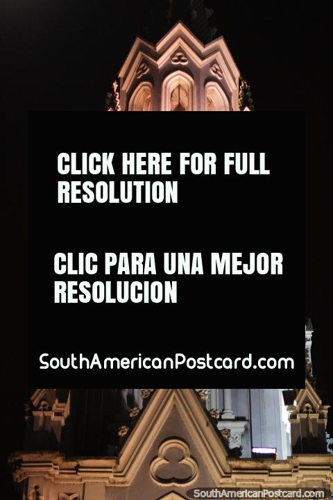 Glowing clock and bell tower of Ermita Church in Cali. (480x720px). Colombia, South America.