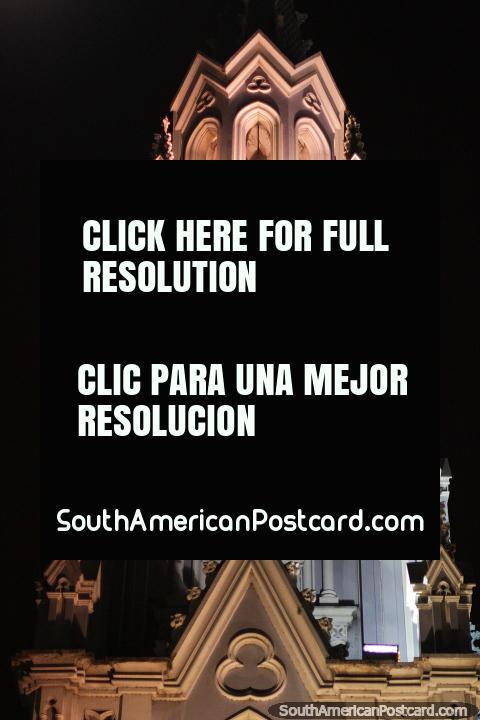 Reloj y campanario que brilla intensamente de la Iglesia de Ermita en Cali. (480x720px). Colombia, Sudamerica.
