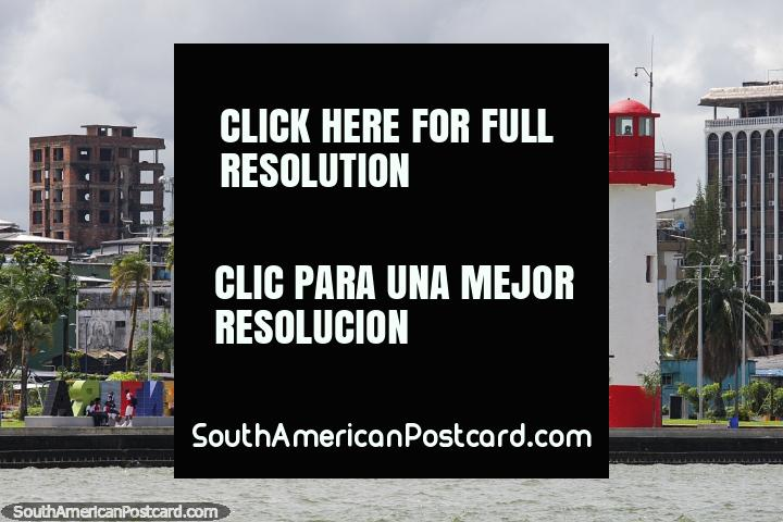 Lighthouse, city and waterfront in Buenaventura, view from a boat. (720x480px). Colombia, South America.