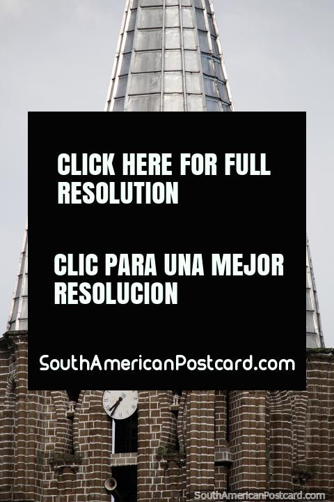 Clock tower with small and large silver steeples, the church in Jardin. (480x720px). Colombia, South America.