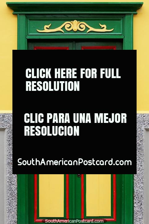 Green and yellow door with a checkered design, the architecture of Jardin. (480x720px). Colombia, South America.