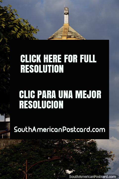 White clock tower of Church La Valbanera in Pereira beside Park La Libertad. (480x720px). Colombia, South America.