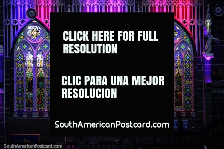 Shades of purple, pink and red, the spectacular light show and arched windows at Las Lajas church. (720x480px). Colombia, South America.