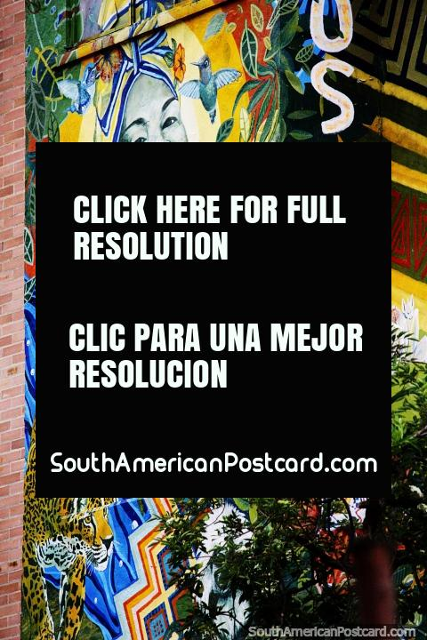 Spectacular mural of a smiling woman and a tiger on the side of a hostel in Bogota. (480x720px). Colombia, South America.