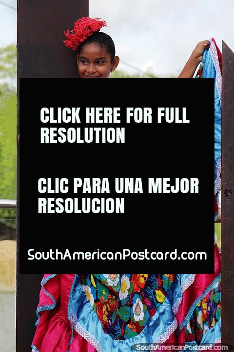 Young lady in traditional dress, colorful and a white top, Monteria. (480x720px). Colombia, South America.