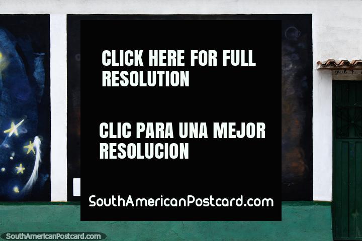 Homem toca violão clássico, mural de rua em Villa del Rosario, Cucuta. (720x480px). Colômbia, América do Sul.