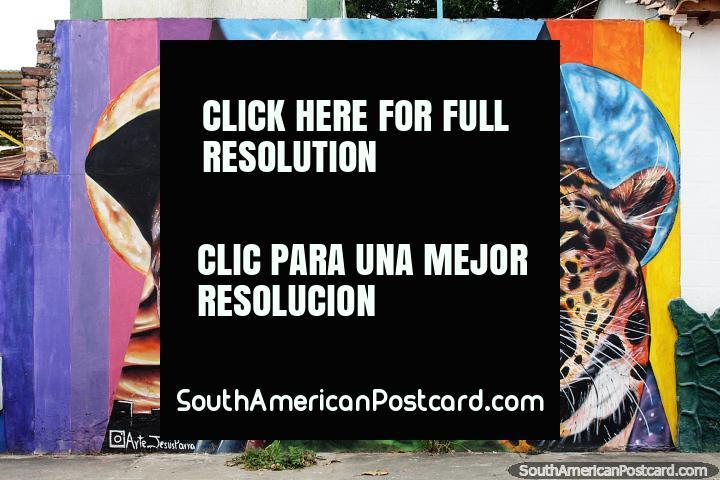 Homem e um tigre, grande arte de rua da Arte Jesus Parra em Villa del Rosario, Cucuta. (720x480px). Colômbia, América do Sul.