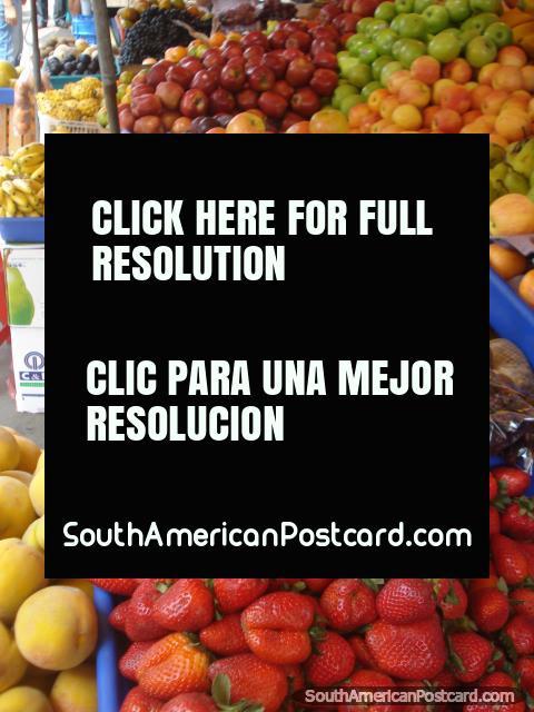 Machala fruit market, strawberries, kiwifruit, peaches, mangos, bananas. (480x640px). Ecuador, South America.