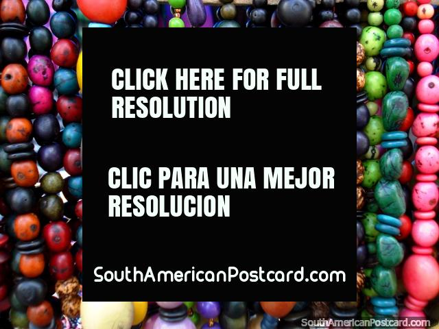 Necklaces and beads made of seeds in amazing colors, Otavalo. (640x480px). Ecuador, South America.