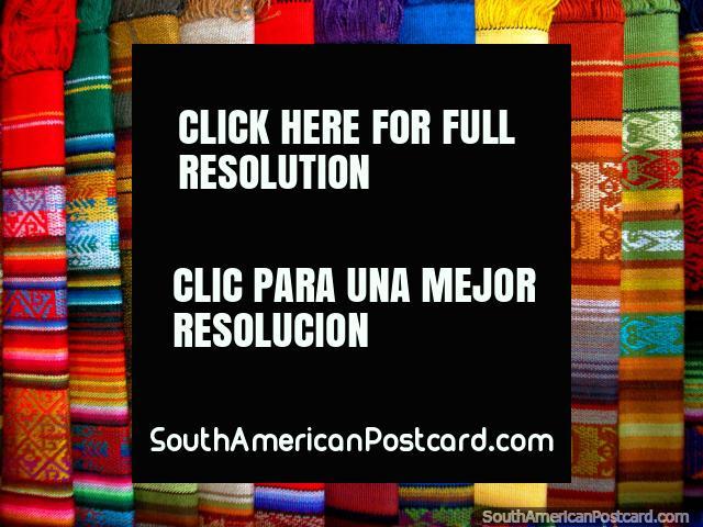 Colorful shawls displayed at market, Otavalo. (640x480px). Ecuador, South America.