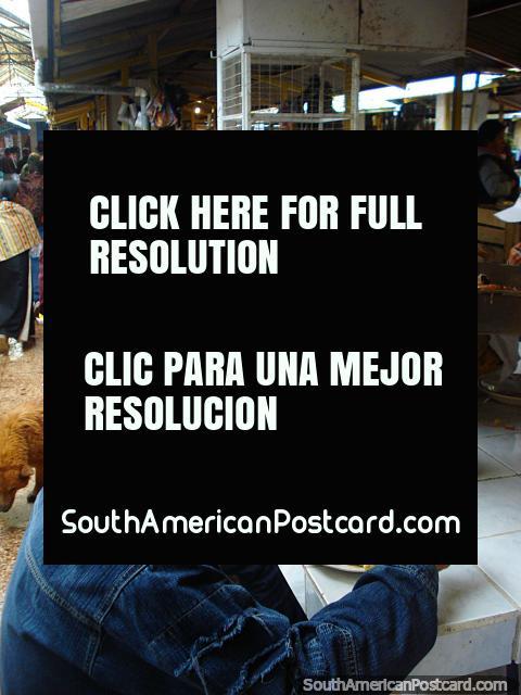The Otavalo food market has freshly made pork meals to eat. (480x640px). Ecuador, South America.