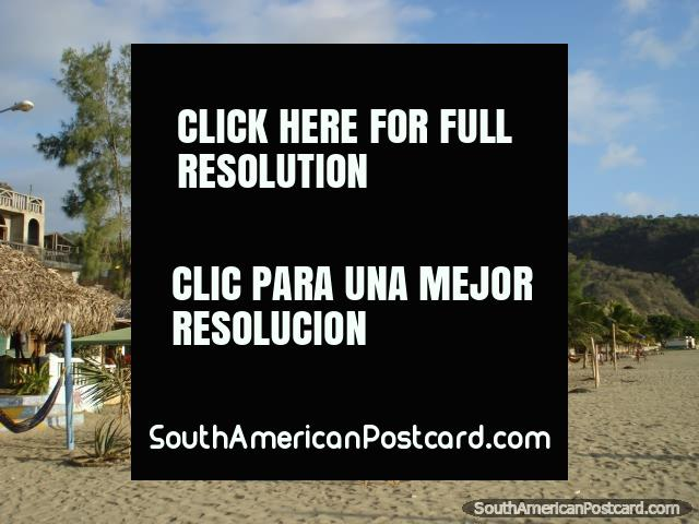 Puerto Lopez beach, chairs gathered around a fire from the night before. (640x480px). Ecuador, South America.