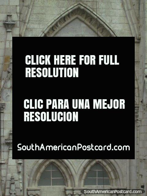 The arched clock on the tower of Basilica del Voto Nacional church, Quito. (480x640px). Ecuador, South America.