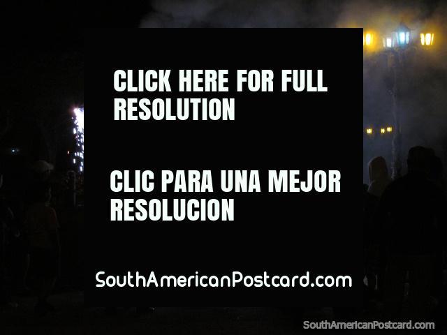 The locals of Vilcabamba enjoy the festival fireworks. (640x480px). Ecuador, South America.