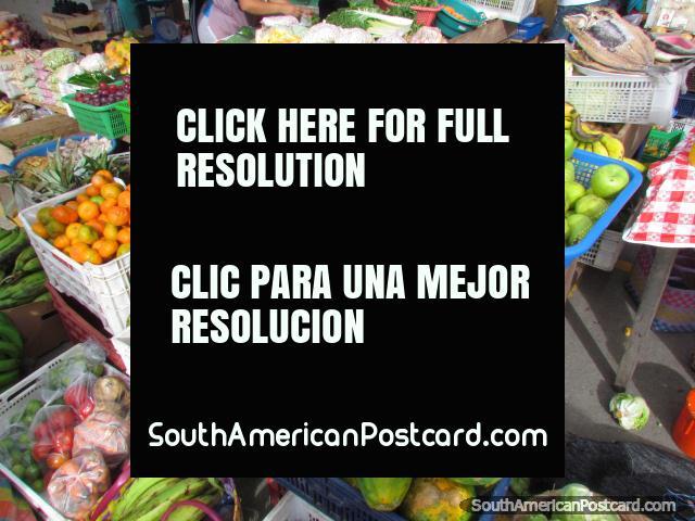 Fresh fruit produce at Vilcabamba markets, apples, pineapples, bananas. (640x480px). Ecuador, South America.