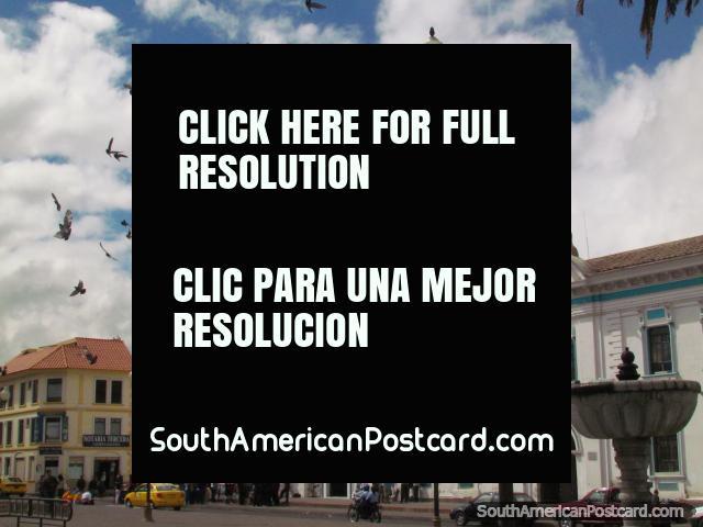 Historical center in Latacunga, San Agustin Church, pigeons flying. (640x480px). Ecuador, South America.