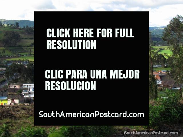 The town, church and pastures of a place called Cristobal Colon. (640x480px). Ecuador, South America.