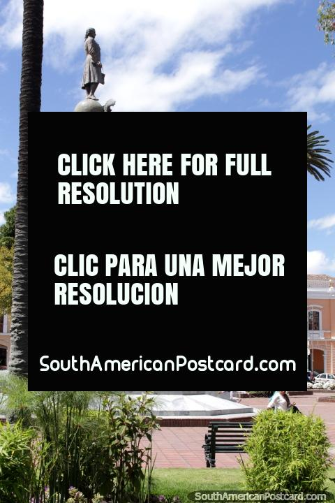 The central monument at Parque Maldonado and a palm tree in Riobamba. (480x720px). Ecuador, South America.
