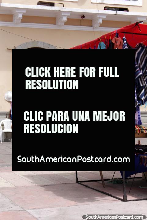 Shawls and hammocks for sale at Plaza Roja in Riobamba. (480x720px). Ecuador, South America.