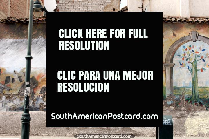 2 figures move a huge rock, wall mural in Riobamba. (720x480px). Ecuador, South America.