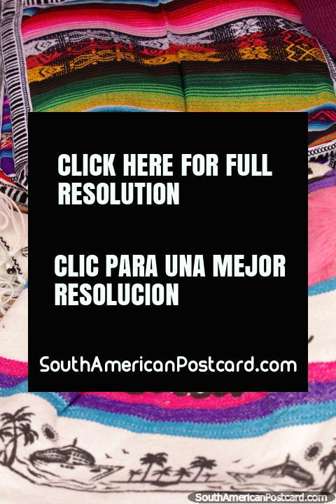 The colors of Ecuador, cloths, bags and more for sale at Plaza Roja, Riobamba. (480x720px). Ecuador, South America.
