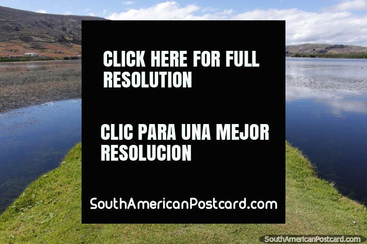 A grass pathway out into the lagoon at Colta, 35mins south of Riobamba. (720x480px). Ecuador, South America.