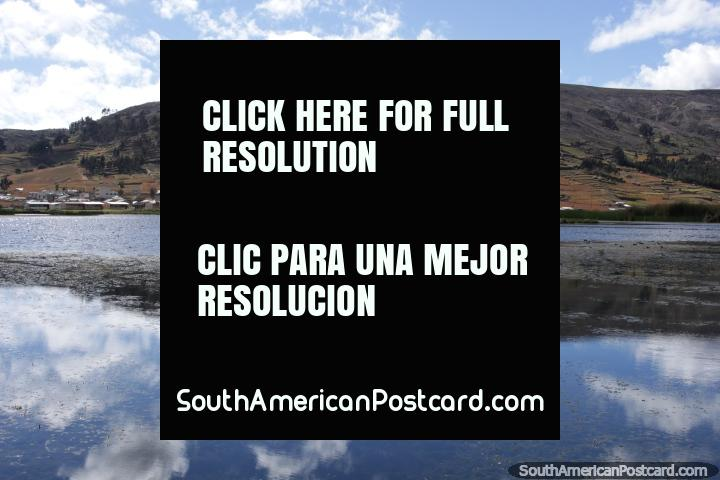 Colta Lagoon and the hills and community nearby, south of Riobamba. (720x480px). Ecuador, South America.