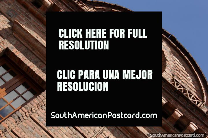 The top part of the brick facade of Hotel Victoria in Cuenca. (720x480px). Ecuador, South America.