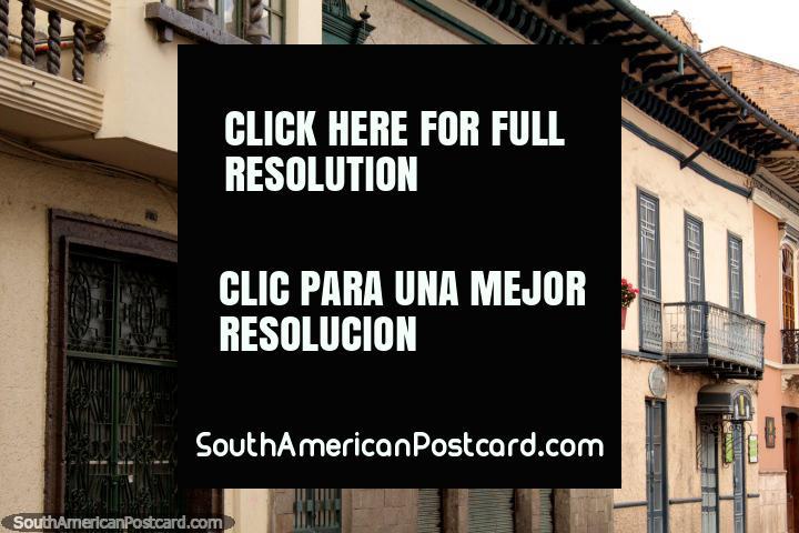 Red flowers along iron balconies, nice facades in Cuenca. (720x480px). Ecuador, South America.