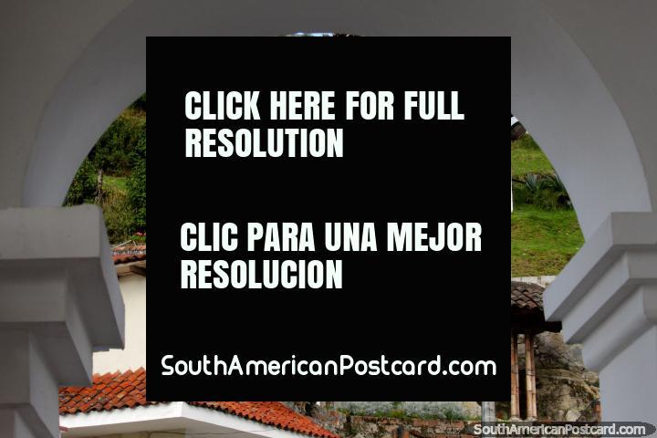 3 statues on the hill in Turi, view through an arch, Cuenca. (720x480px). Ecuador, South America.