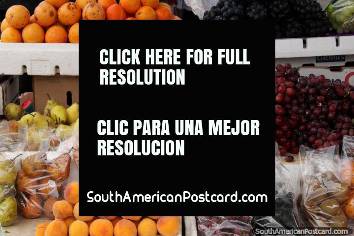 Pears, grapes and peaches and few kiwifruit at Saquisili market. (720x480px). Ecuador, South America.