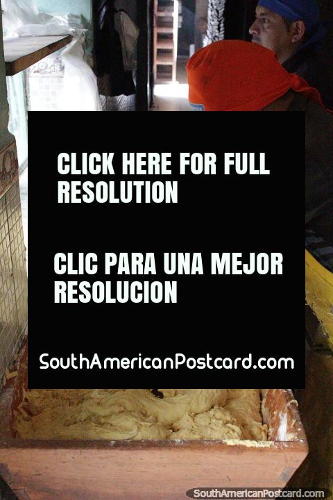 Preparation of the bizcocho mixture at San Pedro Bizcochos in Cayambe. (480x720px). Ecuador, South America.