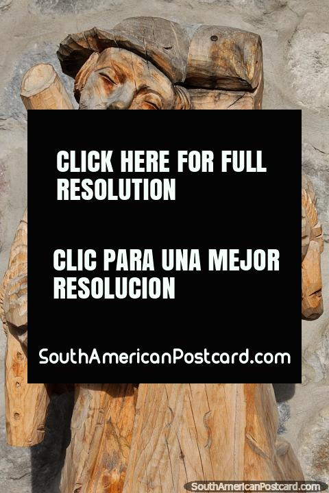 Musician plays a double bass, San Antonio wood carving in Ibarra. (480x720px). Ecuador, South America.