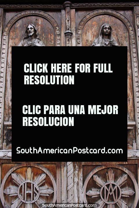 Antique wooden doors of a school in Ibarra - Hermanas Franciscanas de Maria Inmaculada. (480x720px). Ecuador, South America.
