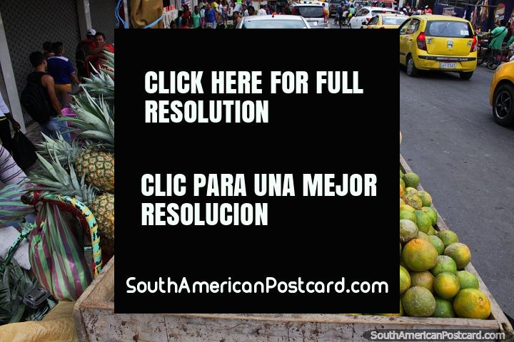 Rock melon, pineapples and oranges for sale in the street in Esmeraldas. (720x480px). Ecuador, South America.