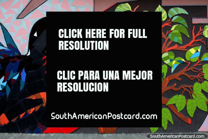 Tiled mural of a great sea bird and beautiful green tree in Atacames, fantastic street art. (720x480px). Ecuador, South America.