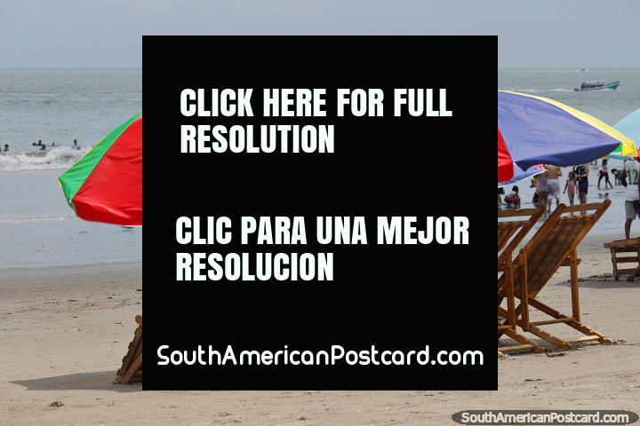 Rent a beach chair underneath an umbrella and enjoy the day beside the sea at Atacames. (720x480px). Ecuador, South America.