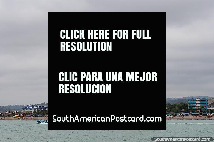 View of Atacames beach from the parasailing platform, someone high in the air. (720x480px). Ecuador, South America.