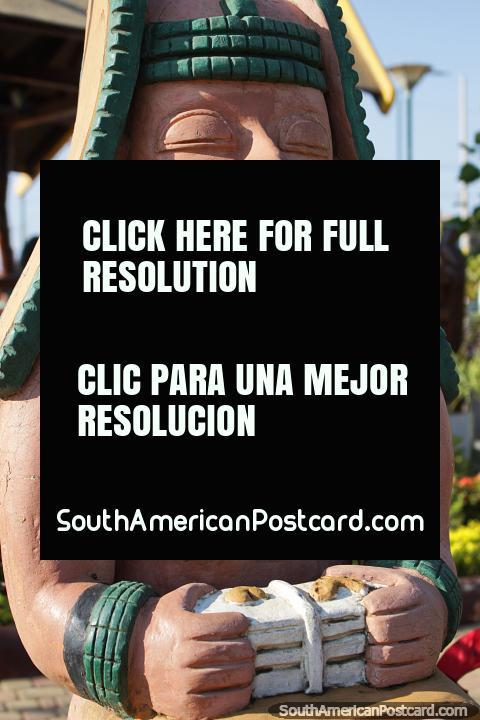 Orfebre, a person who works with precious metals, ceramic figure in central park, Jama. (480x720px). Ecuador, South America.