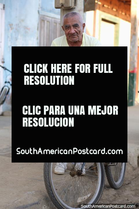 Elder man with a bicycle, a local of Jama, a coastal town near the beach. (480x720px). Ecuador, South America.