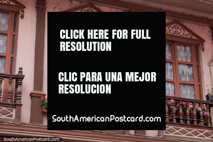 Old facade with wooden balcony and flower pots in Zaruma. (720x480px). Ecuador, South America.