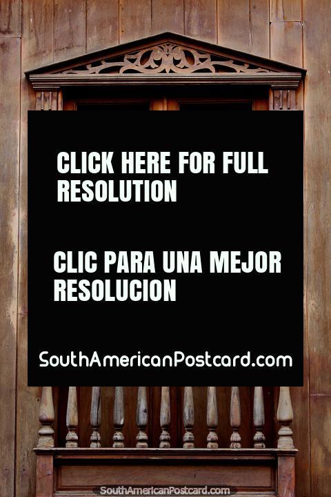 Wooden balcony, doors, windows and shutters, an icon of Zaruma. (480x720px). Ecuador, South America.