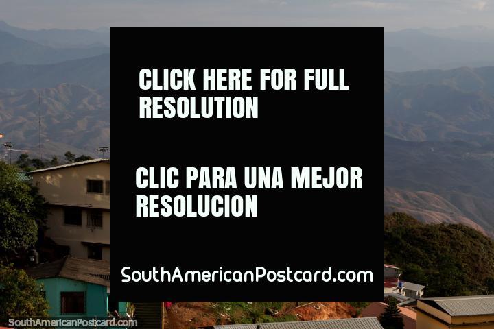 Miguel Sanchez Astudillo College (1969) in Zaruma, overlooking distant hills. (720x480px). Ecuador, South America.