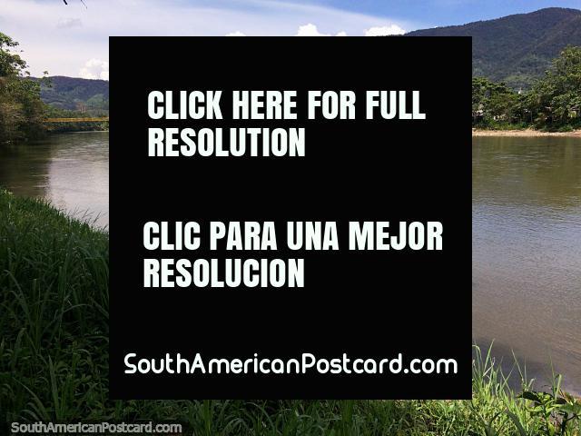 Beside the Zamora River in Yantzaza, distant bridge, calm waters and green hills. (640x480px). Ecuador, South America.