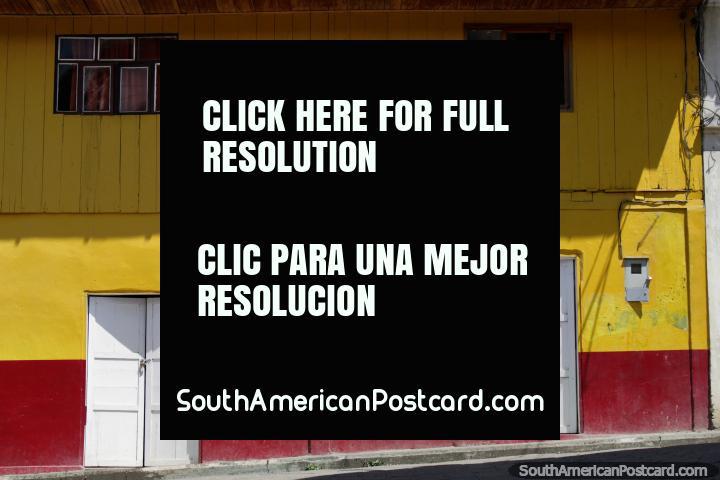 Bright yellow facade of a wooden building in Limon, town south of Macas. (720x480px). Ecuador, South America.
